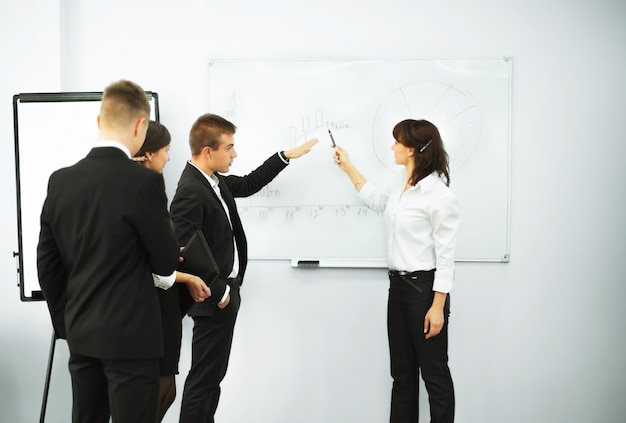 Businesswoman giving a presentation to business team
