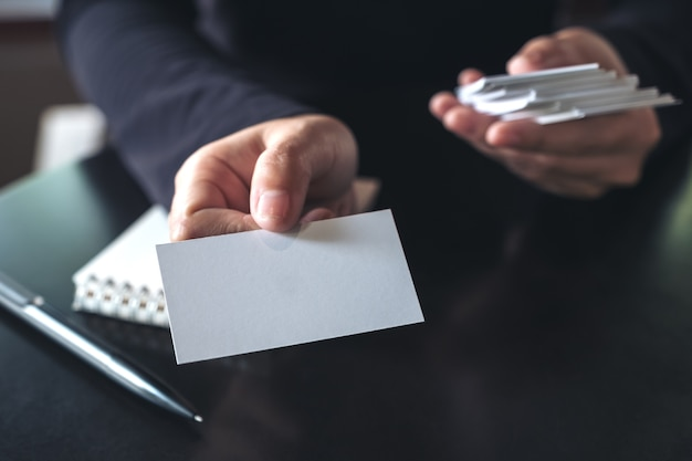 Businesswoman giving and showing an empty business card