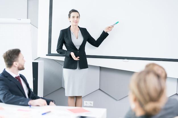 Businesswoman giving speech in office