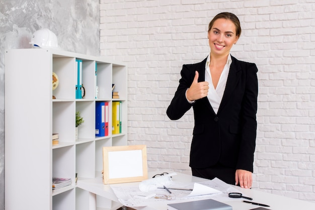 Businesswoman giving a thumbs up