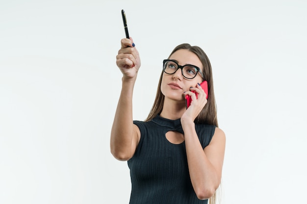 Businesswoman in glasses black dress with phone points