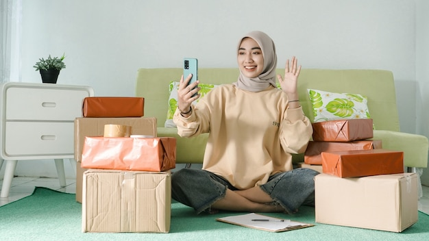 Businesswoman greets on mobile screen
