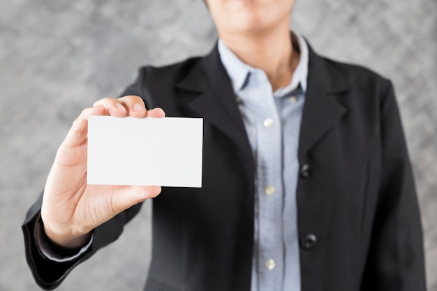 Businesswoman hand holding blank business card