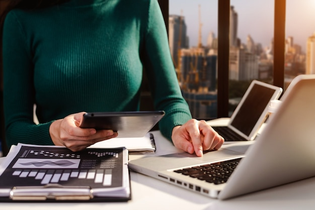 Businesswoman hand working with new modern computer using on smartphone and tablet as concept
