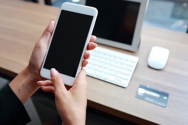 Businesswoman hands using table and cell phone