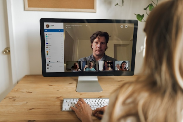 Businesswoman having a video conference with colleagues during coronavirus quarantine
