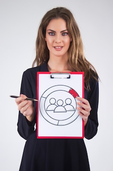 Businesswoman hold clipboard paper report document with team work icon, diagram.