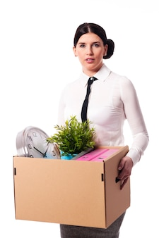 Businesswoman holding a box of personal items