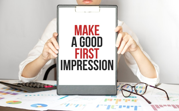 Businesswoman holding a card with text make a good first impression