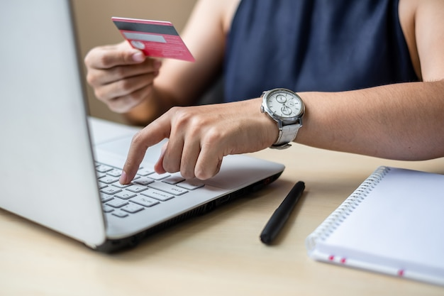 Businesswoman holding credit card  for online shopping