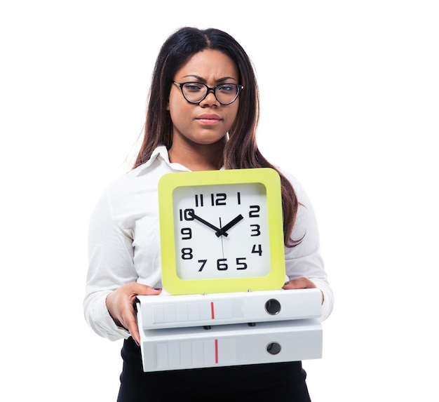 Businesswoman holding folders and clock