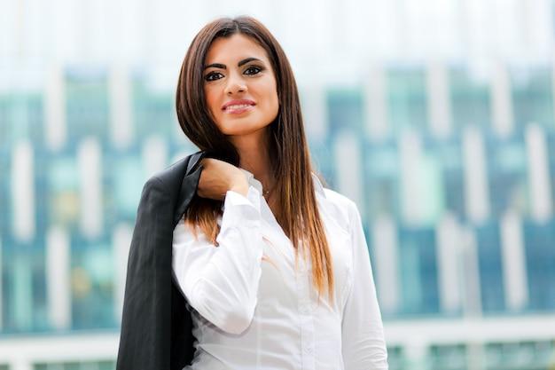 Businesswoman holding her jacket