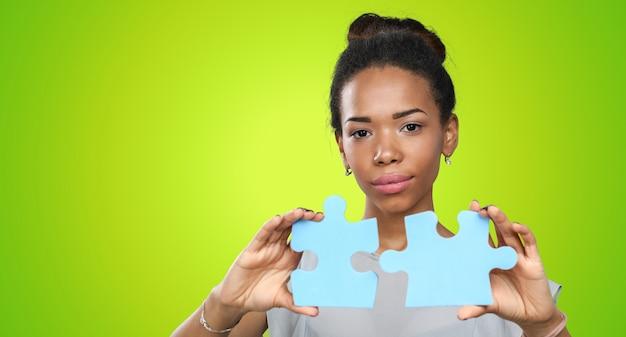 Businesswoman holding puzzle pieces