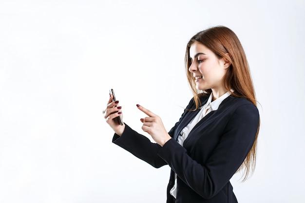 Businesswoman holds smartphone
