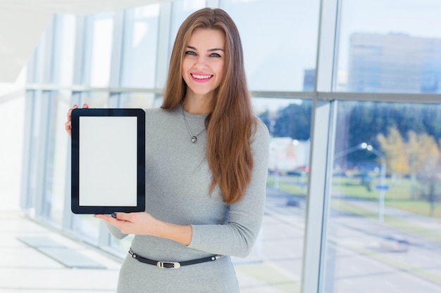 Businesswoman holds a tablet in his hands at the office