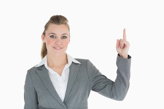 Businesswoman is pointing up
