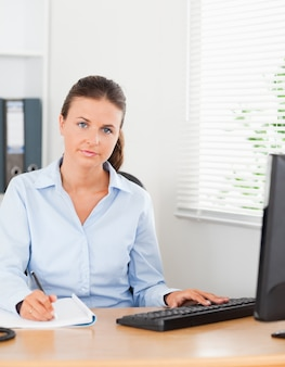 Businesswoman looking into camera