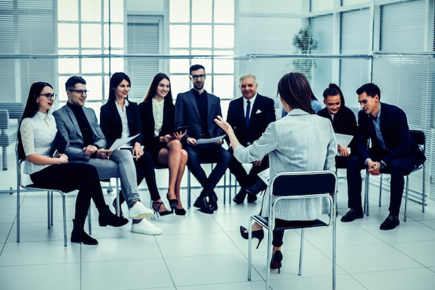 Businesswoman makes a report at a meeting with the business team. business and education