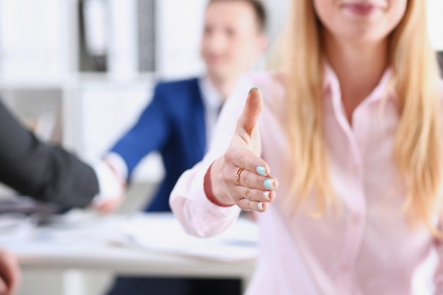 Businesswoman offer hand to shake as hello in office closeup.