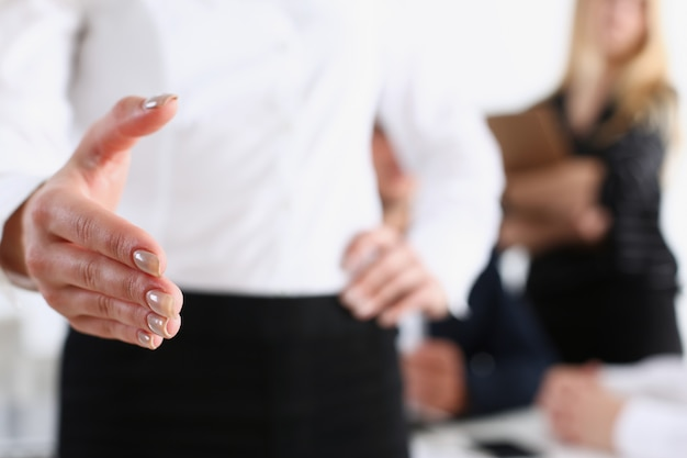 Businesswoman offer hand to shake as hello