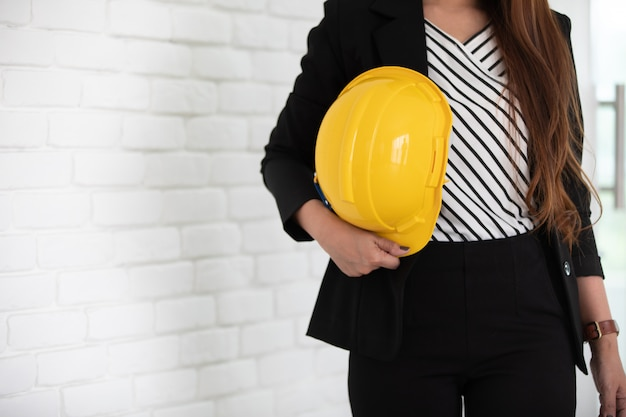 Businesswoman in office with hard hat