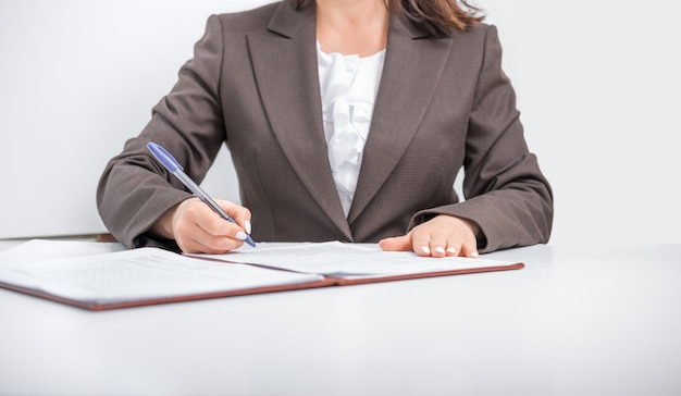 Businesswoman, office worker signing documents, business concept