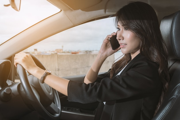 Businesswoman on the phone in her car.