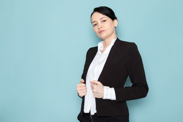 Businesswoman posing in black suit