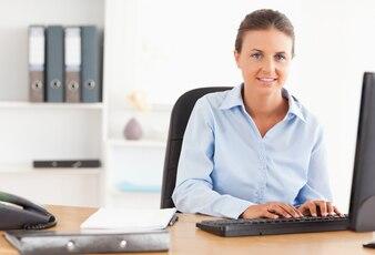 Businesswoman posing in her office