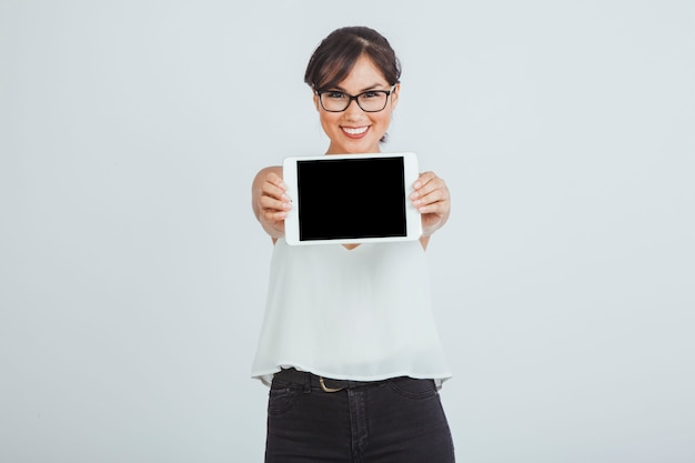Businesswoman posing with tablet