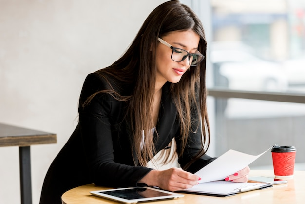 Businesswoman reading document