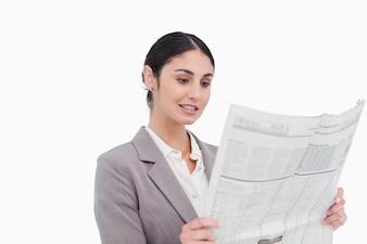Businesswoman reading news paper