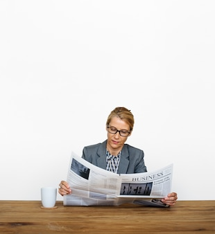 Businesswoman reading newspaper information coffee cup