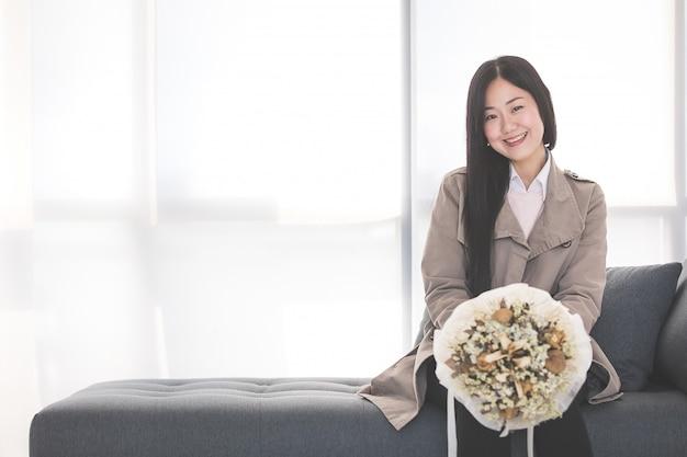 Businesswoman receive a bouquet.