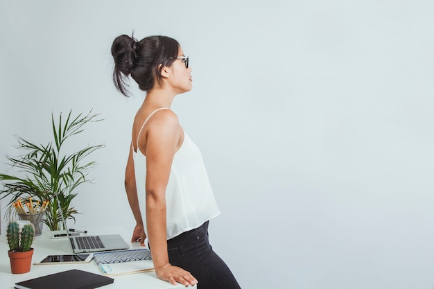 Businesswoman resting on her desk