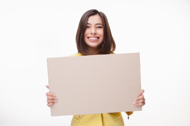 Businesswoman showing board or banner with copy space on white