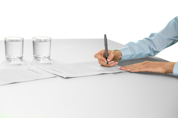 Businesswoman signing contract. the decision is made. a careful choice. building a big company.