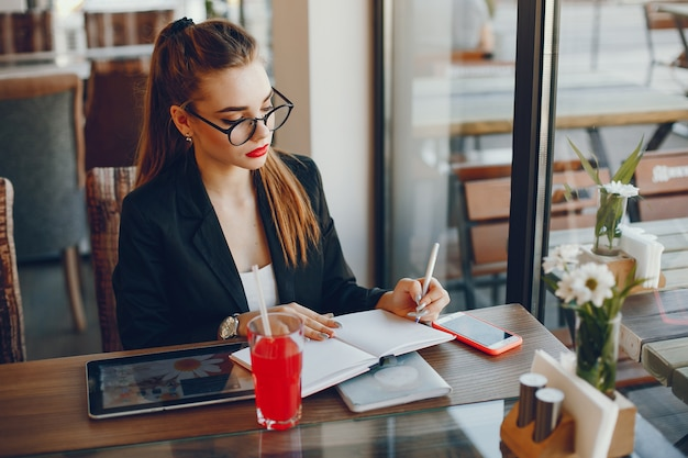 Businesswoman sitting in a cafe