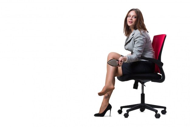 Businesswoman sitting isolated on white