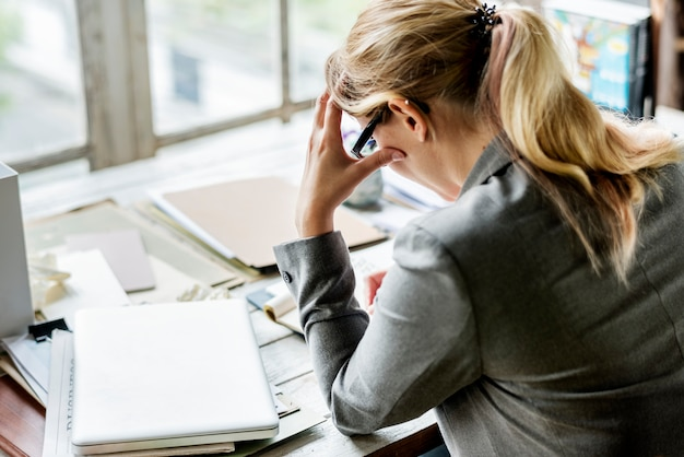 Businesswoman sitting stressful thoughful at office