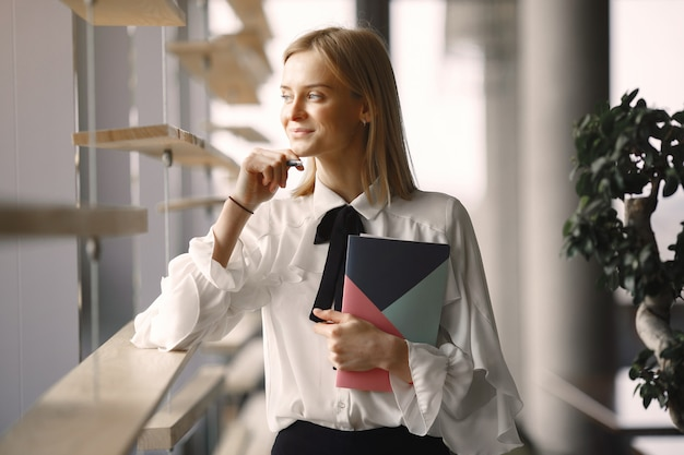 Businesswoman sitting at the table with a notebook