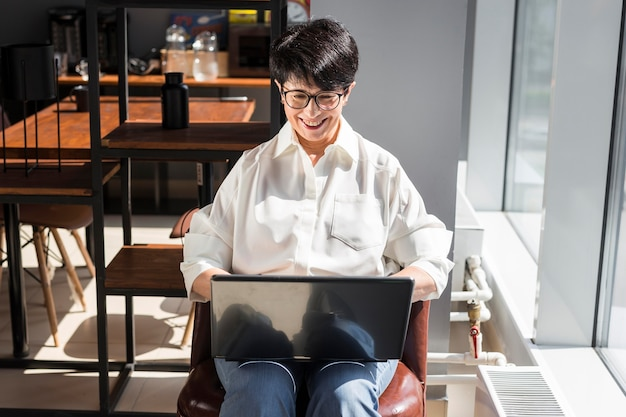 Businesswoman smiling and working