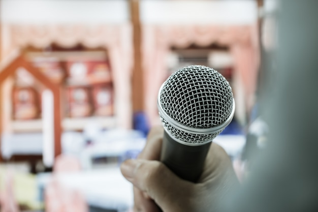 Businesswoman speech or speaking with microphone in seminar hall