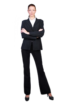 Imprenditrice in piedi contro isolato su bianco