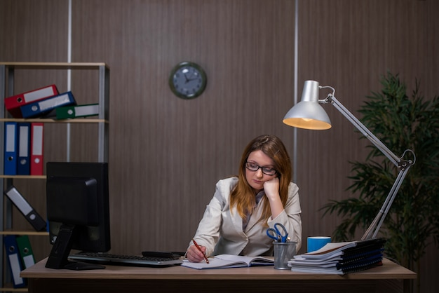 Businesswoman staying in the office for long hours