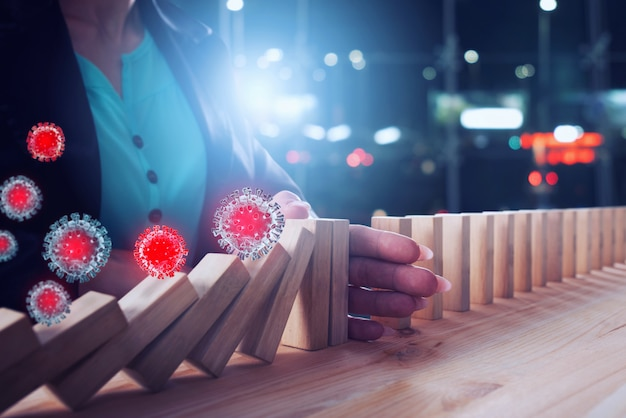 Businesswoman stops a chain fall by viruses like domino game