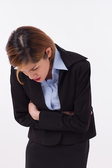 Businesswoman suffering from stomachache
