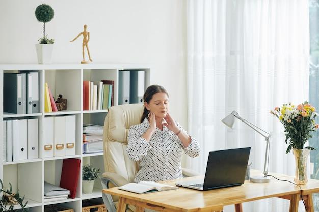 Businesswoman surefing from stiff neck