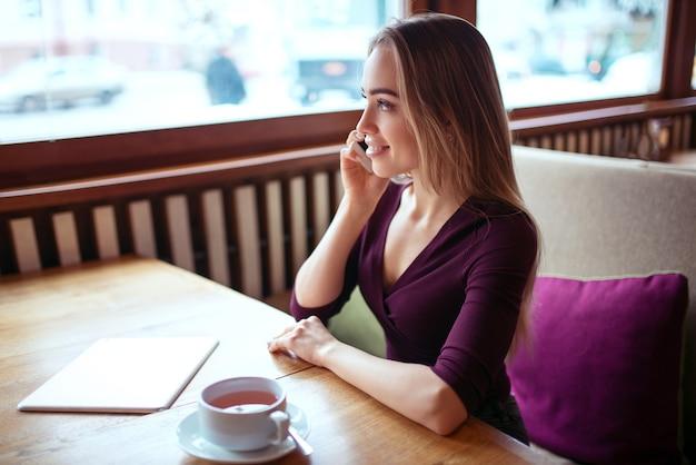 Businesswoman talking by smartphone
