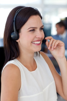Businesswoman talking on a headset in a call centre